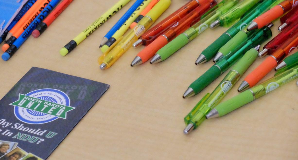 North Dakota United brochure with pens and pencils
